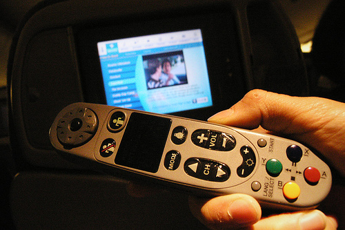 KLM in-flight entertainment screen and remote control